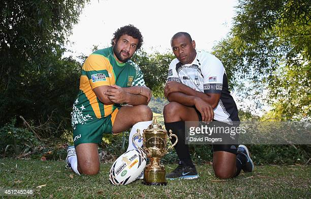 Akapusi Qera the Fiji captain and Stan Wright captain of the Cook Islands pose with the Webb Ellis Cup ahead of the Rugby World Cup 2015 Qualifier at...