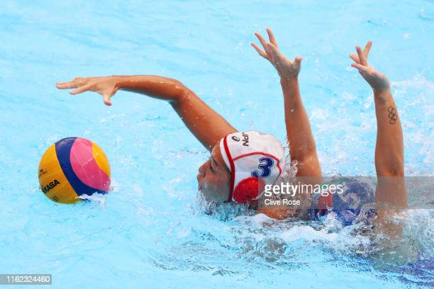 Akari Inaba of Japan competes for the ball against Elisa Queirolo of Italy during their Women's Water Polo Preliminary round match on day four of the...