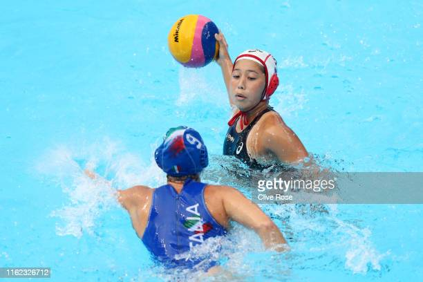 Akari Inaba of Japan takes a shot against Giulia Emmolo of Italy during their Women's Water Polo Preliminary round match on day four of the Gwangju...