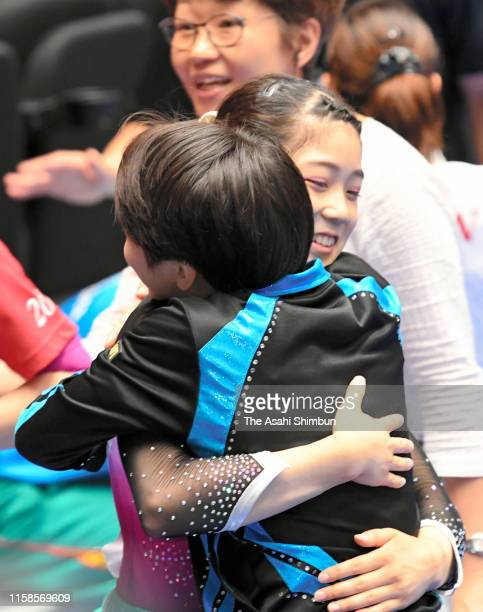 Akari Matsumura is congratulated by Mai Murakami as she qualified for the national team member on day two of the 73rd All Japan Artistic Gymnastics...