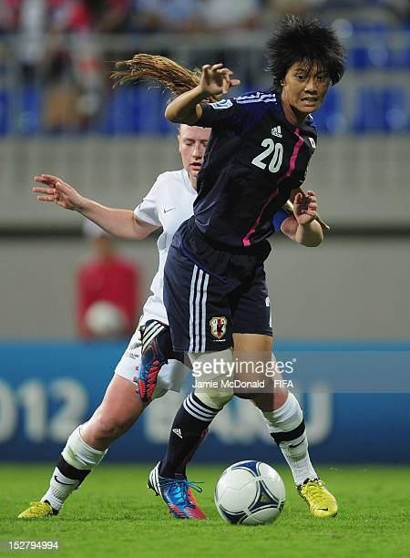 Akari Shiraki of Japan battles with Catherine Bott of New Zealand during the FIFA U17 Women's World Cup 2012 Group C match between New Zealand and...