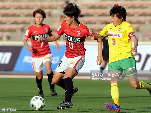 Akari Shiraki of Urawa Red Diamonds and Naoko Sakuramoto of JEF United Chiba compete for the ball during the Nadeshiko League match between Urawa Red...