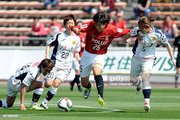 Akari Shiraki of Urawa Reds Ladies and Junko Kai of INAC compete for the ball during the Nadeshiko League match between Urawa Red Diamonds and INAC...