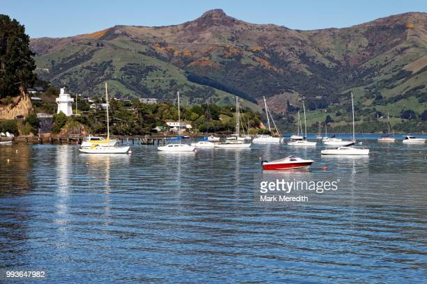 Akaroa Harbour with moored yachts and boats and mountain range