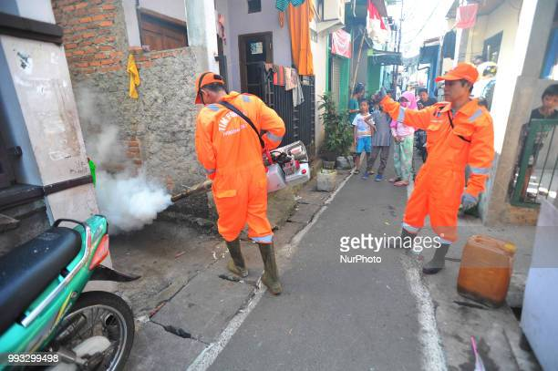 akarta health workers fogged the crowded residential street and narrow alley in Bukit Duri Jakarta in July2018 The fumigation to anticipate and...
