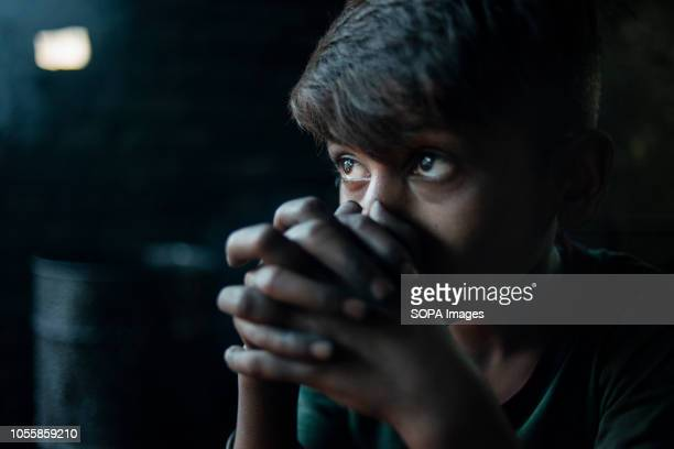 KERANIGANJ DHAKA BANGLADESH Akash a shipyard worker seen taking a moment to rest during his daily work Child labour is illegal but often child...