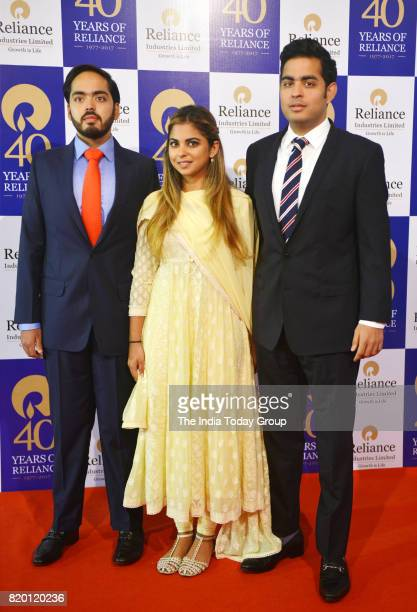 Akash Ambani Anant Ambani and Isha Ambani at the company's 40th Annual General Meeting in Mumbai