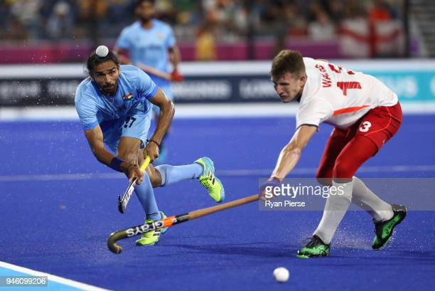 Akashdeep Singh of India and Sam Ward of England in the Men's bronze medal match between England and India during Hockey on day 10 of the Gold Coast...