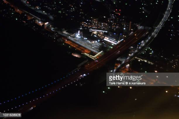 Akashi Strait Bridge in Hyogo prefecture in Japan night time aerial view from airplane