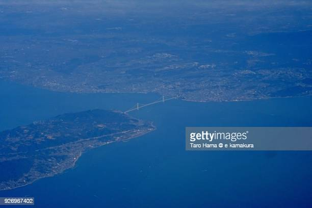 Akashi Strait Bridge in Seto Inland Sea, connected Japan main land and Awaji island in Hyogo prefecture in Japan daytime aerial view from airplane