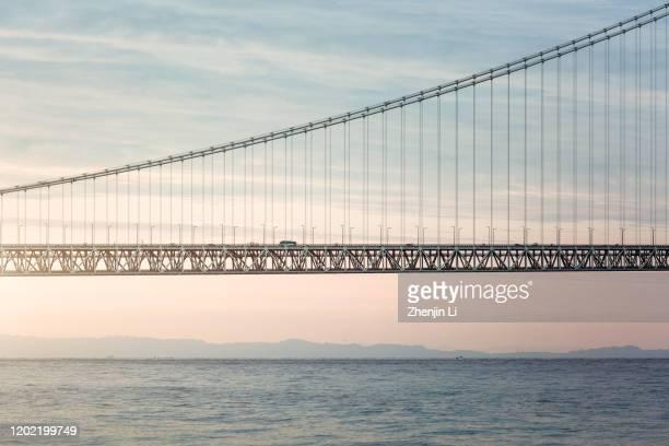 akashi-kaikyo bridge above sea level close-up / kobe, japan - 兵庫県 ストックフォトと画像