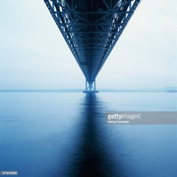 akashi-kaikyo suspension bridge in fog, japan - kobe japan stock pictures, royalty-free photos & images