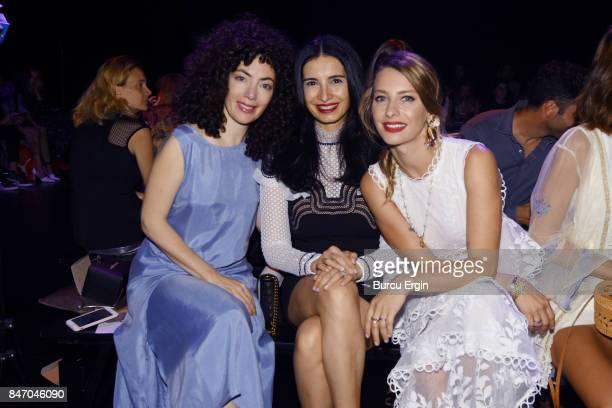 Akasya Asilturkmen Basak Sayan and Tuba Unsal are seen during MercedesBenz Istanbul Fashion Week September 2017 at Zorlu Center on September 14 2017...