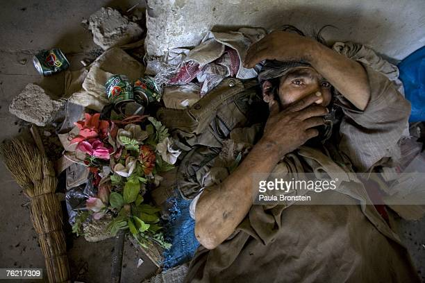Akbar a heroin addict for five years rests on the floor of an abandoned building August 22 2007 in Kabul Afghanistan He begs during the day to get...