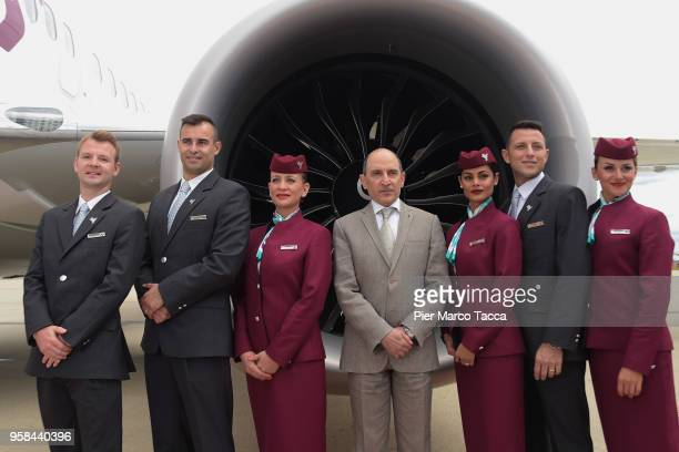 Akbar Al Baker CEO of Qatar airways pose with hostess and steward with the new uniform in front of a Boeing 737 Max of new the airline Air Italy...