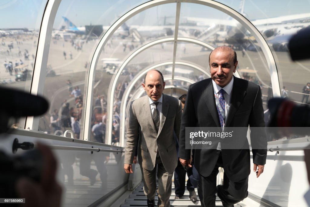 Akbar Al Baker, chief executive officer of Qatar Airways Ltd, left, walks up steps to board a Boeing Co. 777 passenger aircraft during he 53rd International Paris Air Show at Le Bourget, in Paris, France, on Monday, June 19, 2017. The show is the world's largest aviation and space industry exhibition and runs from June 19-25. Photographer: Chris Ratcliffe/Bloomberg via Getty Images