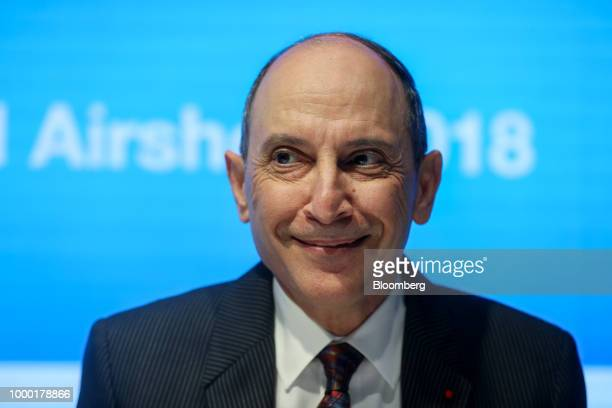 Akbar Al Baker chief executive officer of Qatar Airways reacts during a news conference at the Boeing Co stand on the opening day of the Farnborough...