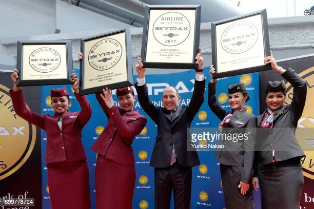 Akbar Al Baker Qatar Airways Chief Executive Officer poses with flight crew members after his company was announced the World's Best Airline along...