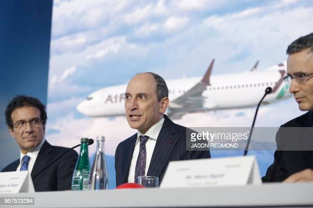 Akbar Al Baker Qatar Airways Group Chief Executive speaks as Ihssane Mounir Senior Vice President of Commercial Sales and Marketing for the Boeing...