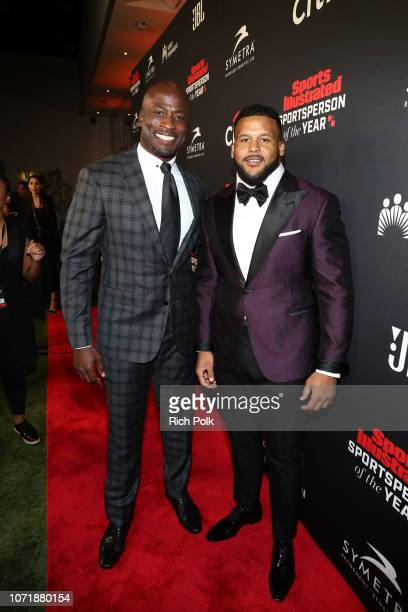 Akbar GbajaBiamila and Performer of the Year award recipient Aaron Donald attend Sports Illustrated 2018 Sportsperson of the Year Awards Show on...