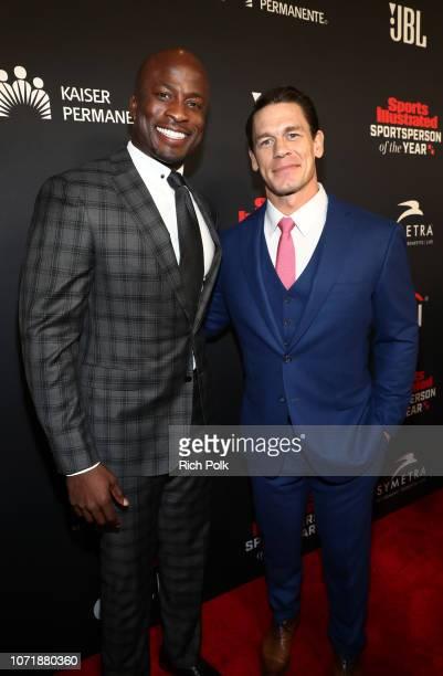 Akbar GbajaBiamila and SI Muhammad Ali Legacy Award recipient John Cena attend Sports Illustrated 2018 Sportsperson of the Year Awards Show on...