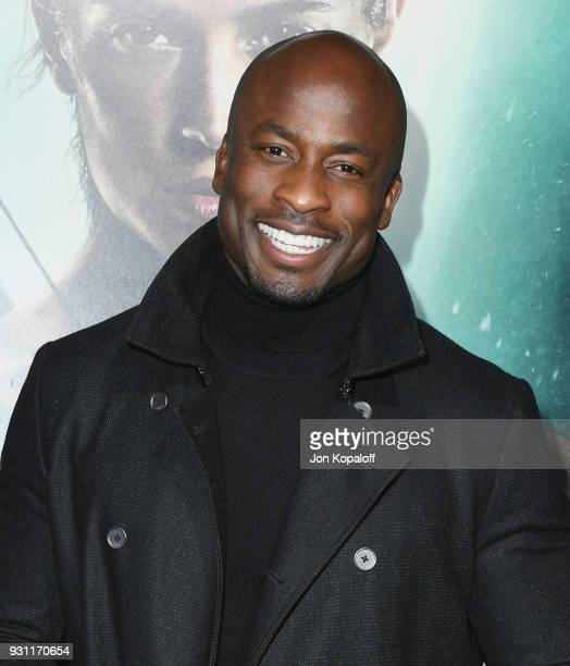 Akbar GbajaBiamila attends the Los Angeles Premiere 'Tomb Raider' at TCL Chinese Theatre IMAX on March 12 2018 in Hollywood California