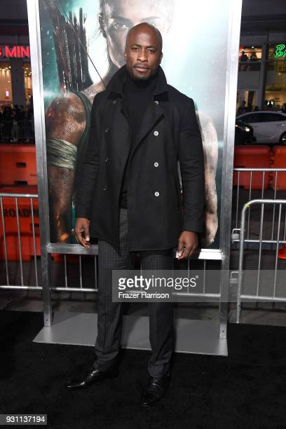 Akbar GbajaBiamila attends the premiere of Warner Bros Pictures' 'Tomb Raider' at TCL Chinese Theatre on March 12 2018 in Hollywood California