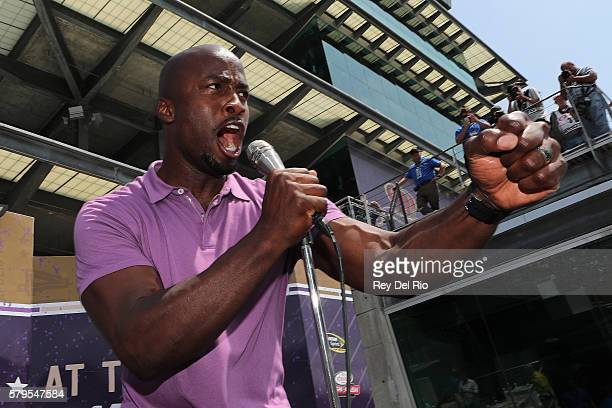 Akbar Gbajabiamila host of American Ninja Warrior participates in prerace festivities prior to the NASCAR Sprint Cup Series Crown Royal Presents the...