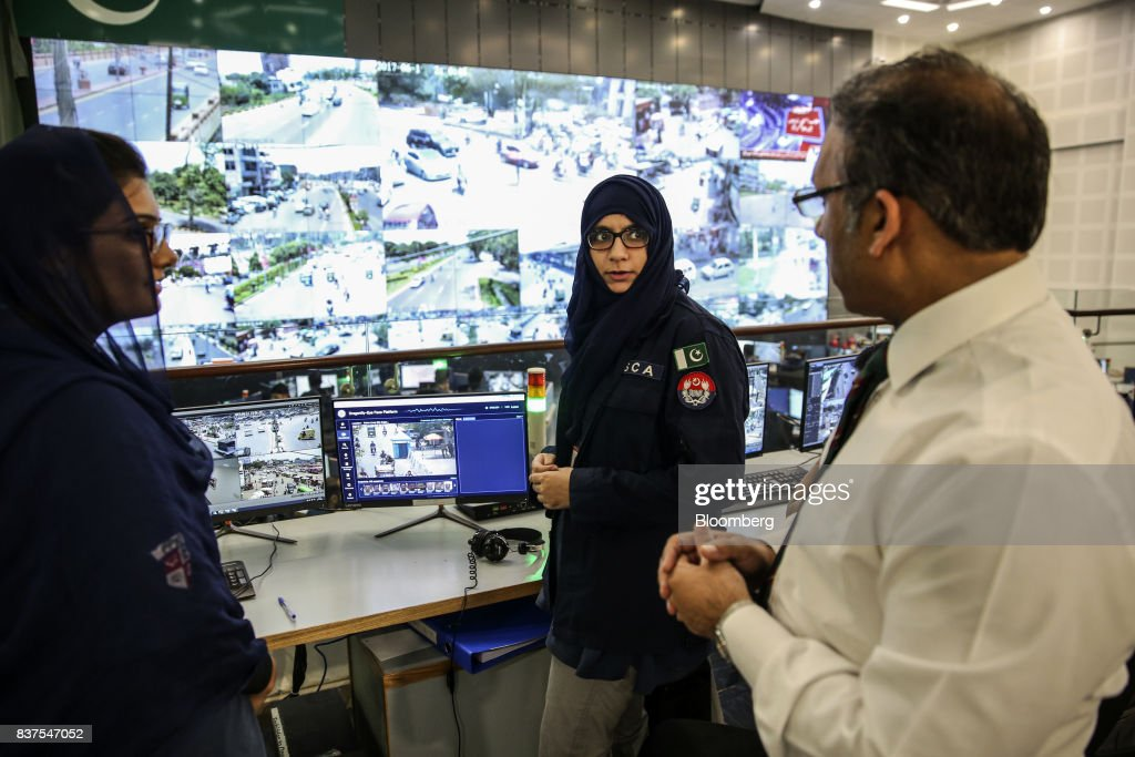 Akbar Nasir Khan, chief operating officer of Punjab Safe Cities Authority (PSCA), right, speaks with police officers at the Punjab Police Integrated Command, Control and Communication Center (IC3) in Lahore, Pakistan, on Tuesday, June 13, 2017. While militants the U.S. identifies as terrorists find refuge in Pakistan, safety within the nation has improved dramatically after it launched a costly, now four-year long military crackdown on domestic insurgent and criminal groups, driving recent economic optimism. Photographer: Asad Zaidi/Bloomberg via Getty Images