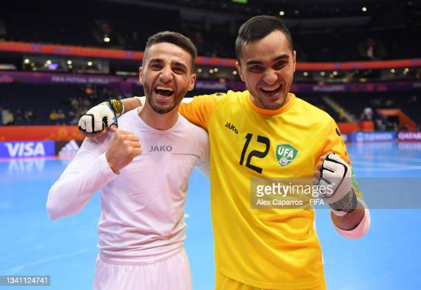 Akbar Usmonov of Uzbekistan and Ernestas Macenis of Lithuania pose for a photo during the FIFA Futsal World Cup 2021 group B match between Egypt and...