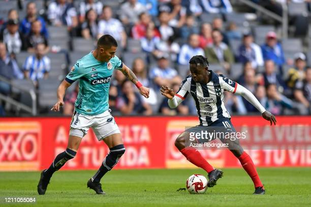 Ake Loba of Monterrey fights for the ball with Luis León of San Luis during the 9th round match between Monterrey and Atletico San Luis as part of...