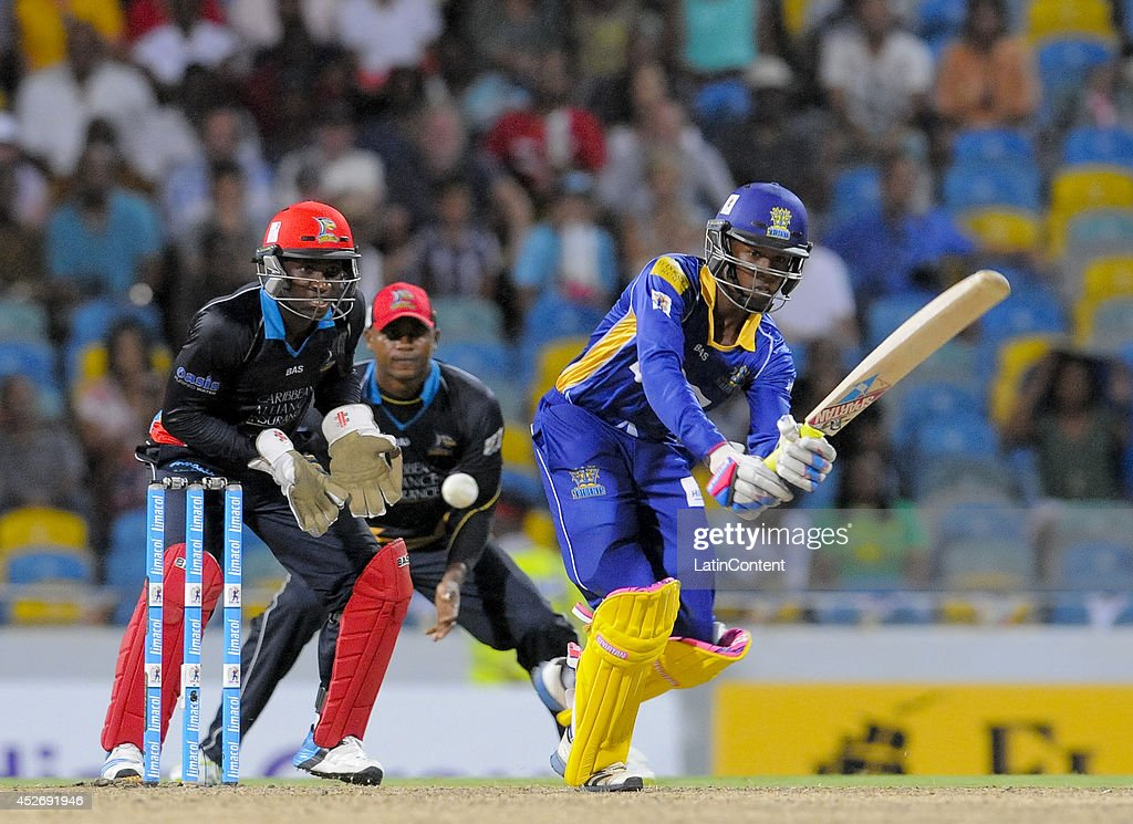 Akeal Hosein (R) of Barbados Tridents hits the winning runs during a match between Barbados Tridents and Antigua Hawksbills as part of the week 3 of Caribbean Premier League 2014 at Kensington Oval on July 25, 2014 in Bridgetown, Barbados.The keeper is Devon Thomas (L) of Antigua Hawksbills.