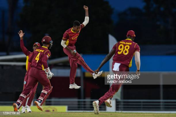 Akeal Hosein of West Indies celebrates the dismissal of Moises Henriques of Australia during the 3rd and final ODI between West Indies and Australia...