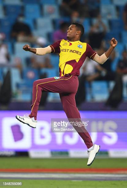 Akeal Hosein of West Indies celebrates the wicket of Liam Livingstone of England during the ICC Men's T20 World Cup match between England and Windies...