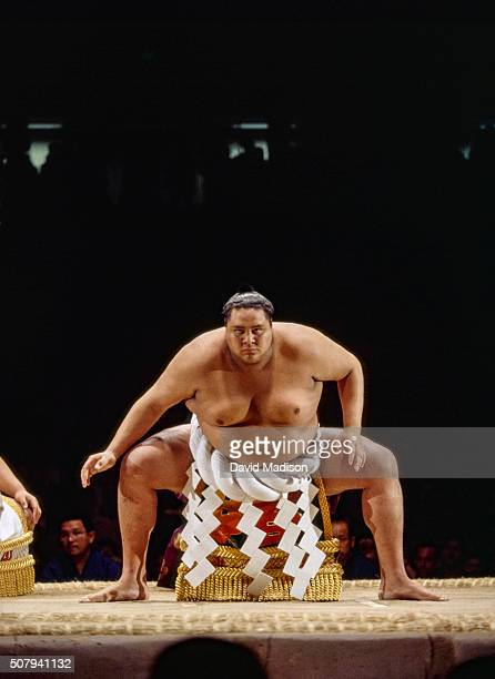 Akebono Taro born in Hawaii as Chad Rowan performs a ritual prior to a match in the 1993 San Jose Basho sumo wrestling tournament held June 45 1993...