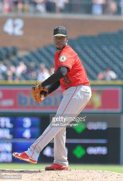 Akeel Morris of the Los Angeles Angels of Anaheim pitches while wearing a special jersey and hat to honor Memorial Day during the game against the...