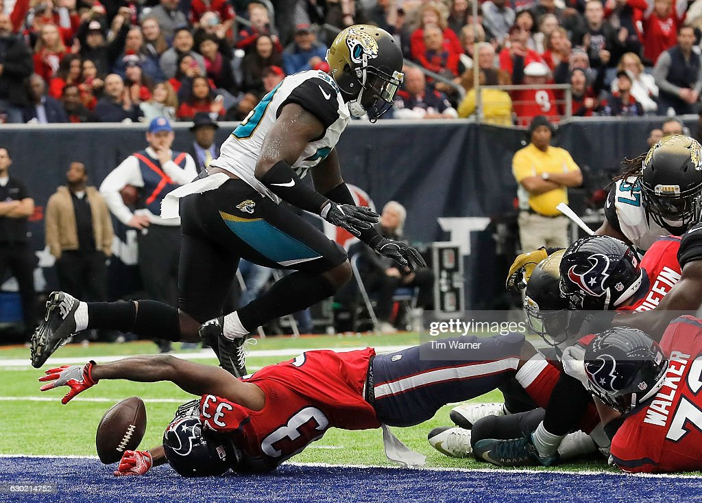 Akeem Hunt #33 of the Houston Texans reaches for a loose ball in the endzone in the second quarter against the Jacksonville Jaguars at NRG Stadium on December 18, 2016 in Houston, Texas.