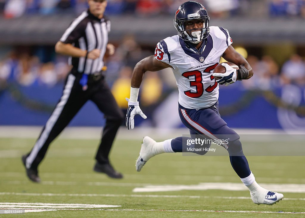 Akeem Hunt #33 of the Houston Texans runs the ball against the Indianapolis Colts at Lucas Oil Stadium on December 20, 2015 in Indianapolis, Indiana.