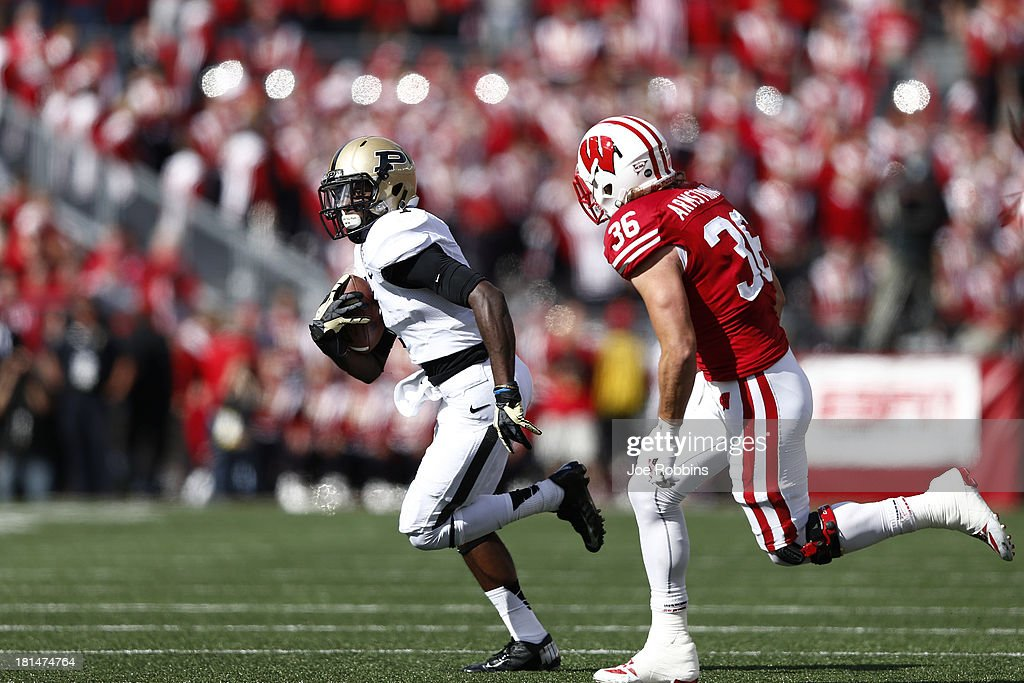 Akeem Hunt #1 of the Purdue Boilermakers runs with the ball against the Wisconsin Badgers during the game at Camp Randall Stadium on September 21, 2013 in Madison, Wisconsin.