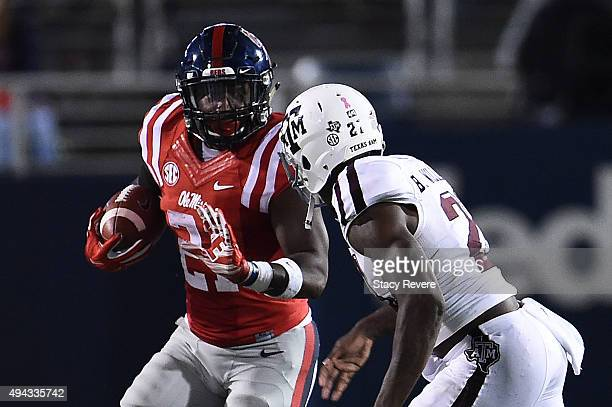 Akeem Judd of the Mississippi Rebels is pursued by Brandon Williams of the Texas AM Aggies during a game at VaughtHemingway Stadium on October 24...