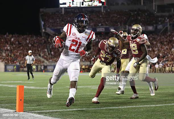 Akeem Judd of the Mississippi Rebels scores a touchdown in the second quarter against the Florida State Seminoles during the Camping World Kickoff at...