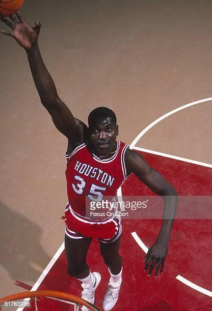 Akeem Olajuwon of the Houston Cougars poses for a jump shot circa 1983.