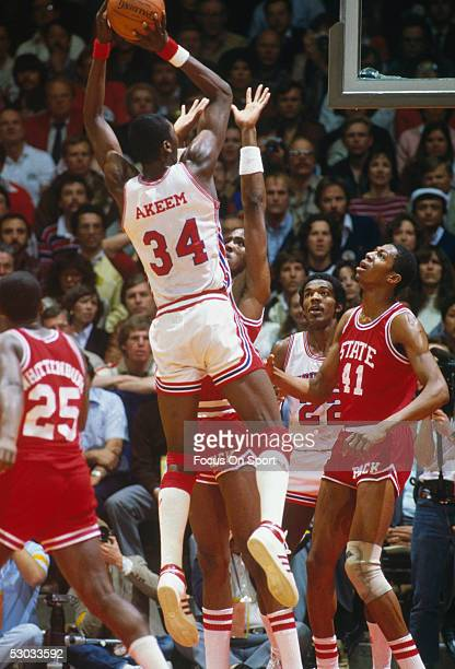 Akeem Olajuwon of the Houston Cougars takes a jumpshot during the NCAA Championship game against the North Carolina State Wolfpack on April 4, 1983...