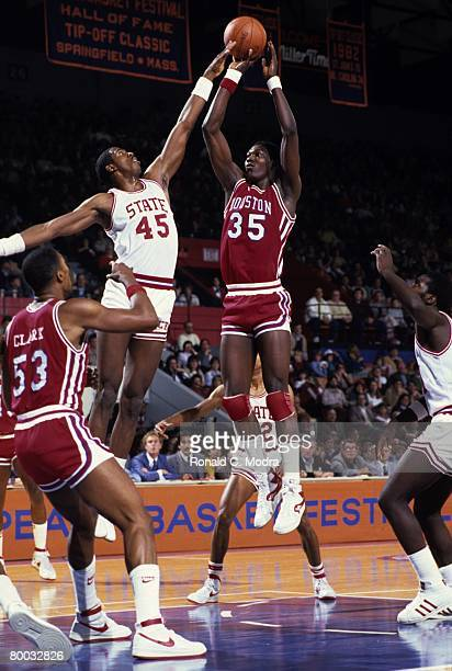 Akeem Olajuwon of the Houston Cougars takes the shot against the North Carolina State Wolfpack on November 19 1983 in Raleigh North Carolina