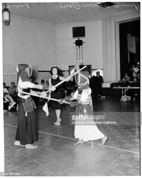 Akemi Tani , August 14 1960. Mitsuhiro Hada -- 83 years;Ted Maesaki -- 17 years;Kendo match.;Caption slip reads: 'Photographer: Olmo. Date: ....