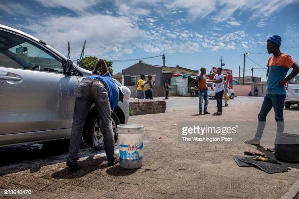 Akena Dubanga who owns this car wash in Gugulethu township says they are no longer using hoses to wash the cars and now they're using buckets in...