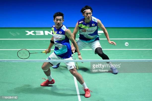 Akeshi Kamura and Keigo Sonoda compete in the men's doubles match against Wang ChiLin and Lee Yang of Chinese Taipei on day three of the Daihatsu...
