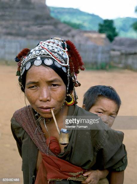 Akha lady smoking a pipe The Akha are a hill tribe of subsistence farmers living in China Laos Burma and Northern Thailand Thailand photographed 1977