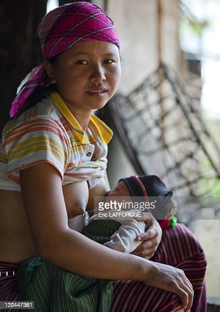 Akha mother and baby in Ban Ta My village Laos on April 10 2009