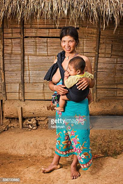 Akha woman holding her baby in Northern Laos